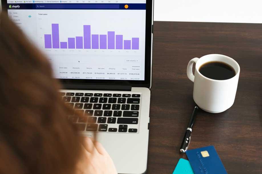 Young graduate analysing data on laptop representing emerging careers